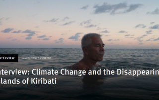 Anote Tong, then president of Kiribati, swims in the lagoon near his home