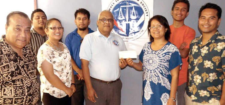 A $500 check was donated by the Marshall Islands Law Society (MILS) to the Radiation Exposure Awareness Crusaders of Humanity – Marshall Islands (REACH-MI)