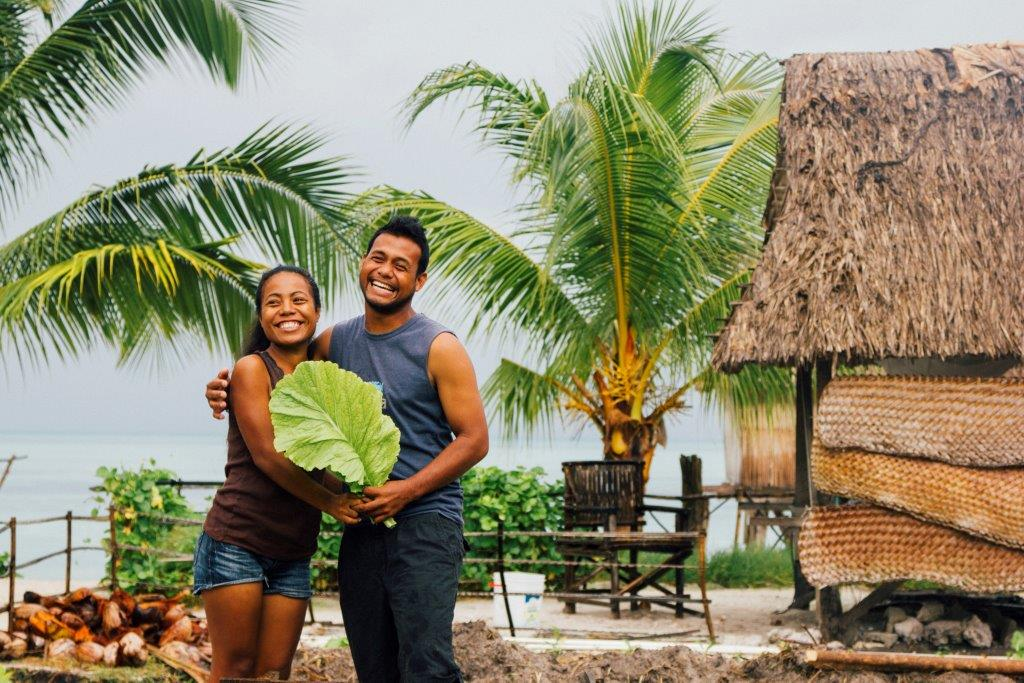 Tinaai Teaua and Kaboua John at Terau Beach Bungalows, the eco-tourism venture that they own and manage in Tebero village, on the small outer island of Abaiang in Kiribati. Photo: Ula Majewski/Oxfam Australia